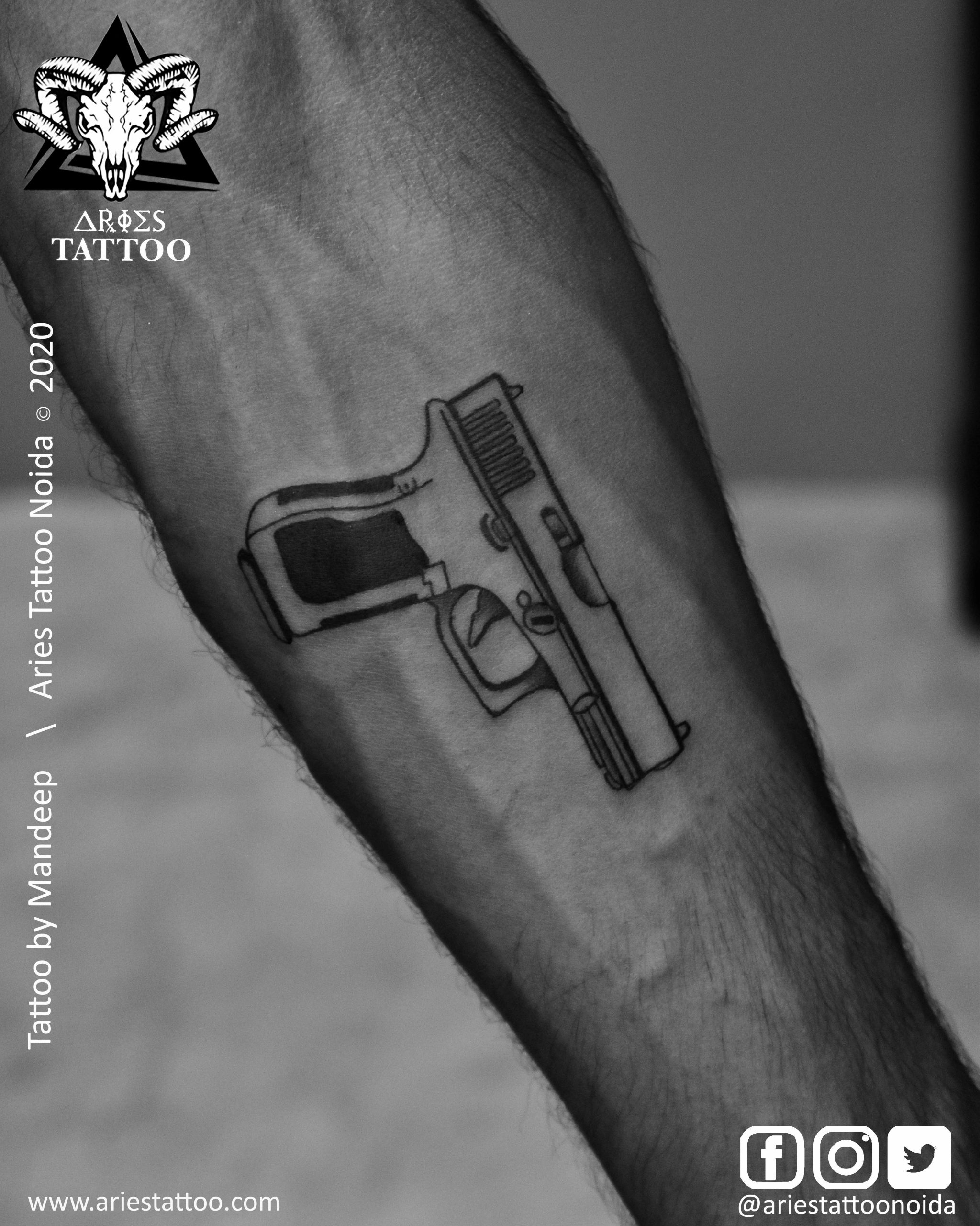 Gun tattoo_Mandeep_|Aries Tattoo Noida | Tattoo Shop and Studio In Noida